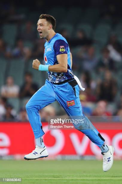 Harry Conway of the Strikers celebrates after claiming the wicket of Mitch Marsh of the Scorchers during the Big Bash League match between the...