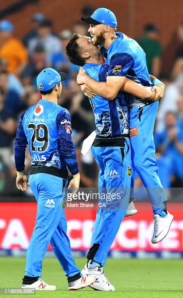 Harry Conway of the Strikers celebrates the last ball and the win by picking up Phil Salt of the Strikers during the Big Bash League match between...