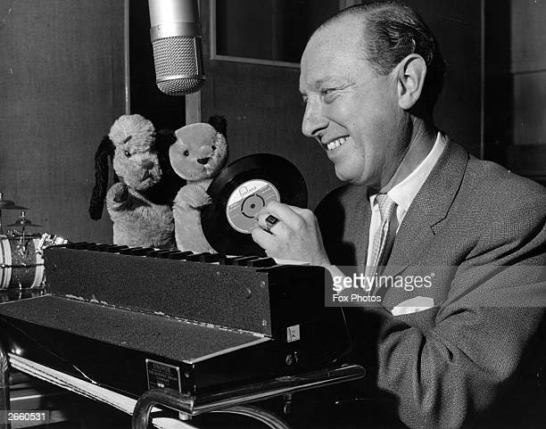 Harry Corbett with his puppets Sooty and Sweep at Fontana Records where Sooty made a record