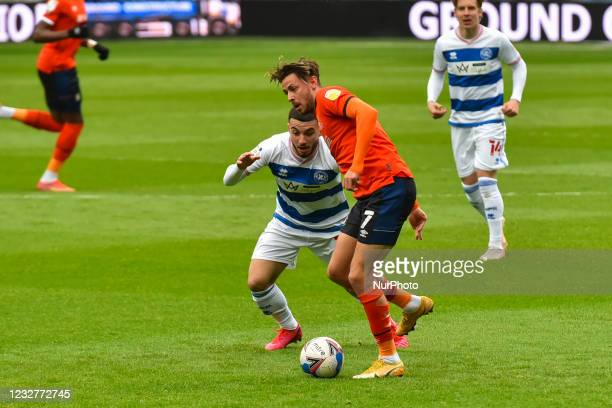 Harry Cornick of Luton town battles for possession with Ilias Chair of QPR during the Sky Bet Championship match between Queens Park Rangers and...