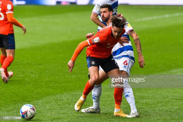 Harry Cornick of Luton town battles for possession with Yoann Barbet of QPR during the Sky Bet Championship match between Queens Park Rangers and...