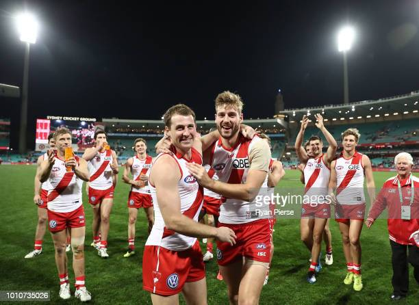 Harry Cunningham and Alex Johnson of the Swans celebrate after the round 20 AFL match between the Sydney Swans and the Collingwood Magpies at Sydney...
