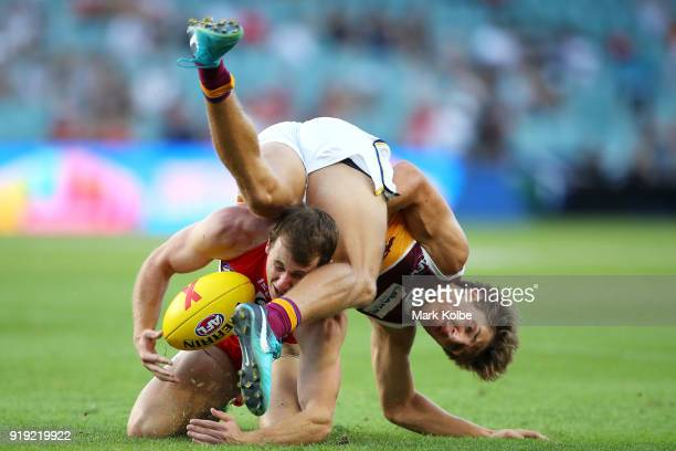Harry Cunningham of the Swans and Zac Bailey of the Lions compete for the ball during the AFLX grand final match between the Sydney Swans and the...