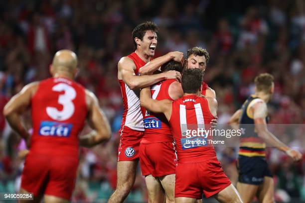Harry Cunningham of the Swans celebrates kicking a goal with team mates during the round five AFL match between the Sydney Swans and the Adelaide...