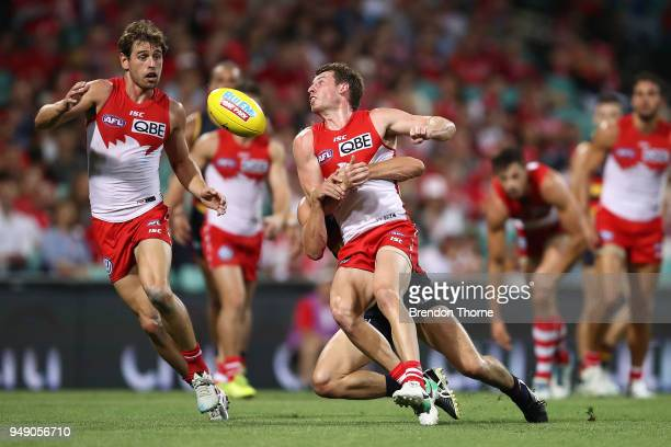 Harry Cunningham of the Swans handpasses during the round five AFL match between the Sydney Swans and the Adelaide Crows at Sydney Cricket Ground on...