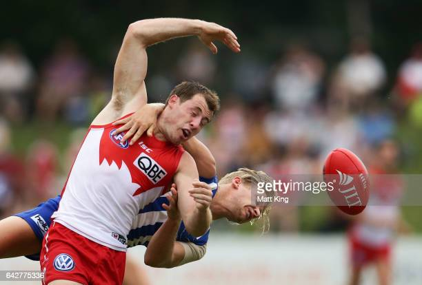 Harry Cunningham of the Swans is challenged by Corey Wagner of the Kangaroos during the 2017 JLT Community Series match between the Sydney Swans and...