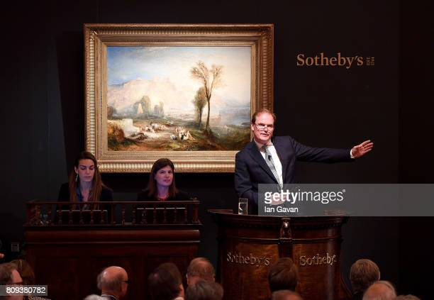 Harry Dalmeny Sotheby's UK Chairman fields bids for JMW Turner's masterpiece 'Ehrenbreitstein' during Sotheby's Old Masters Evening Sale on July 5...