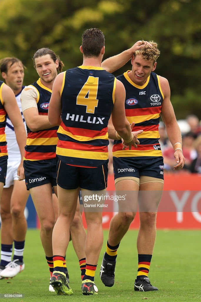 Harry Dear of the Crows celebrates with Josh Jenkins of the Crows and Bryce Gibbs of the Crows after kicking a goal during the JLT Community Series AFL match between the Adelaide Crows and the Fremantle Dockers at Strathalbyn Oval on February 25, 2018 in Adelaide, Australia.