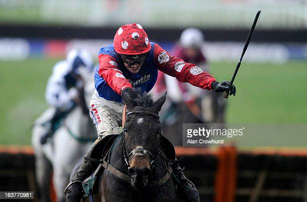 Harry Derham riding Salubrious clear the last to win The Martin Pipe Conditional Jockeys' handicap Hurdle Race during Cheltenham Gold Cup Day at...