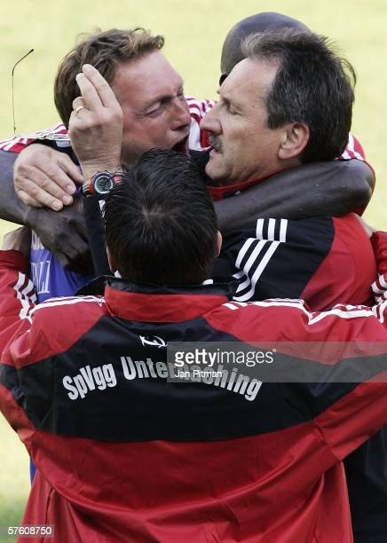 Harry Deutinger the coach of SpVgg Unterhaching hugs teammates after the Second Bundesliga match between SpVgg Unterhaching and VfL Bochum at the...
