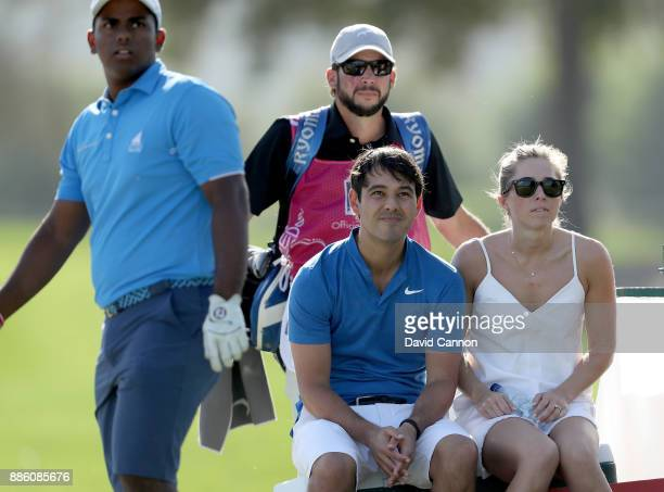 Harry Diamond of Northern Ireland Rory McIlroy's waits on a tee with Rayhan Thomas of India during the proam for the 2017 Dubai Ladies Classic on the...