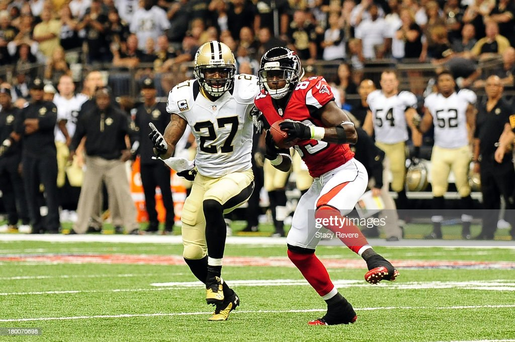 Harry Douglas #83 of the Atlanta Falcons catches a pass in front of Malcolm Jenkins #27 of the New Orleans Saints during a game at the Mercedes-Benz Superdome on September 8, 2013 in New Orleans, Louisiana. The Saints defeated the Atlanta Falcons 23-17.