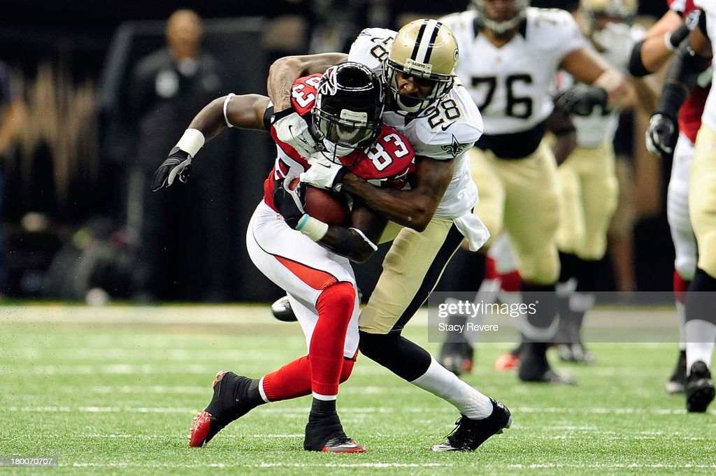 Harry Douglas #83 of the Atlanta Falcons is tackled by Corey White #28 of the New Orleans Saints during a game at the Mercedes-Benz Superdome on September 8, 2013 in New Orleans, Louisiana. The Saints defeated the Falcons 23-17.