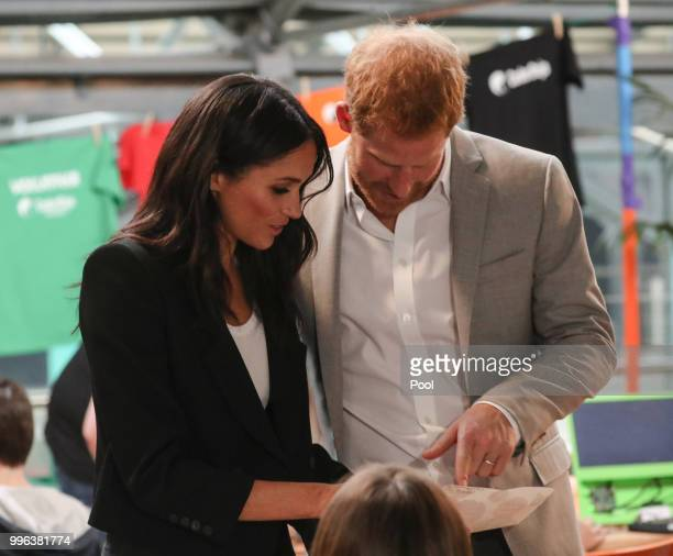 Harry Duke of Sussex and Meghan Duchess of Sussex visit the Dogpatch startup hub in Dublin on the final day of their trip to Ireland on July 11 2018...