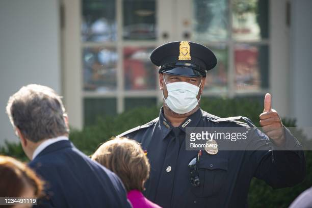 Harry Dunn, private first class with the U.S. Capitol Police, gives a thumbs up as he arrives during a bill signing ceremony in the Rose Garden of...
