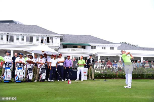 Harry Ellis and Alfie Plant of Team Great Britain and Ireland tees off with partner Alfie Plant against Norman Xiong and Collin Morikawa of Team USA...