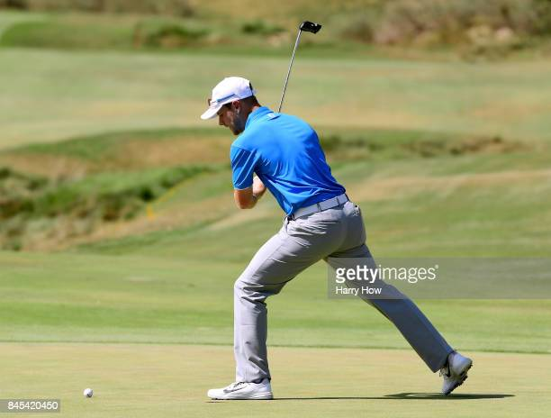 Harry Ellis of Team Great Britain and Ireland reacts to his missed putt on the seventh green in his two and one loss to Collin Morikawa of Team USA...