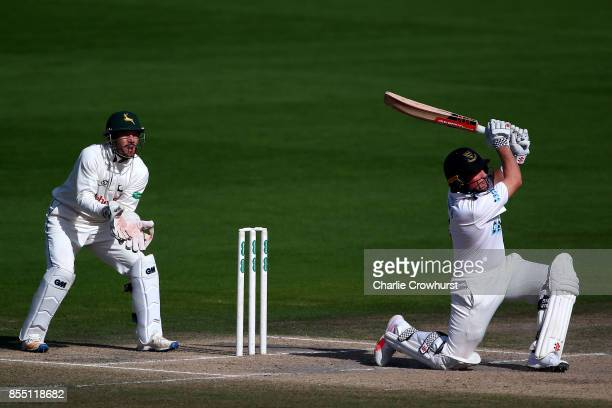 Harry Finch of Sussex hits out while Nottingham keeper Chris Read looks on during day four of the Specsavers County Championship Division Two match...
