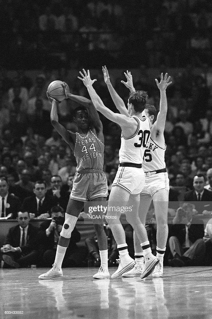 Harry Flournoy (44) of Texas Western looks for an open teammate against the University of Kentucky defense during the Division I Men's Basketball Championship held at Cole Field House on March 19, 1966 in College Park, Maryland. Texas Western defeated Kentucky 72-65 for the national title.