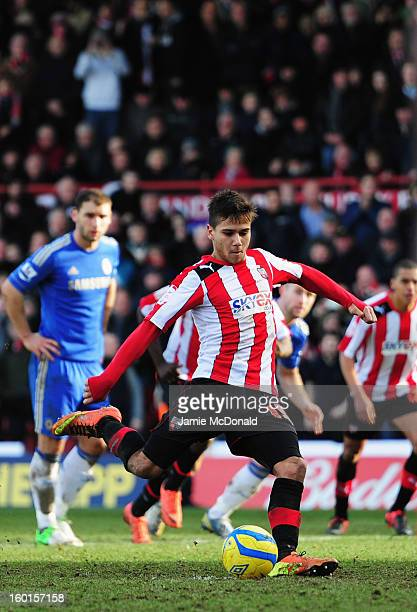 Harry Forrester of Brentford scores his sides second goal from the penalty spot during the FA Cup with Budweiser Fourth Round match between Brentford...