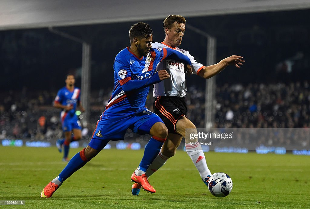 Harry Forrester of Doncaster is challenged by Scott Parker of Fulham during the Capital One Cup Third Round match between Fulham and Doncaster Rovers at Craven Cottage on September 23, 2014 in London, England.