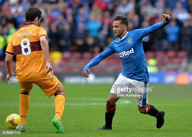 Harry Forrester of Rangers takes on Carl McHugh of Motherwell during the Scottish League Cup First Round Group Stage match between Motherwell FC and...