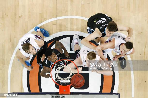 Harry Froling, Daniel Johnson and Anthony Drmic of the 36ers battle for a rebound against Sek Henry and Rob Loe of the Breakers during the round 11...