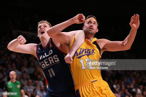 Harry Froling of the 36ers and David Wear of the Kings compete for a rebound during the round five NBL match between the Adelaide 36ers and the...