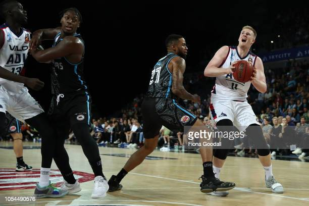 Harry Froling of the Adelaide 36ers looks to shoot with Shawn Long of the NZ Breakers in defence during the round three NBL match between the New...