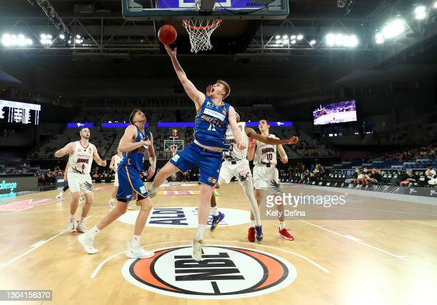 Harry Froling of the Bullets drives to the basket during the NBL Cup match between the Brisbane Bullets and the Illawarra Hawks at John Cain Arena on...