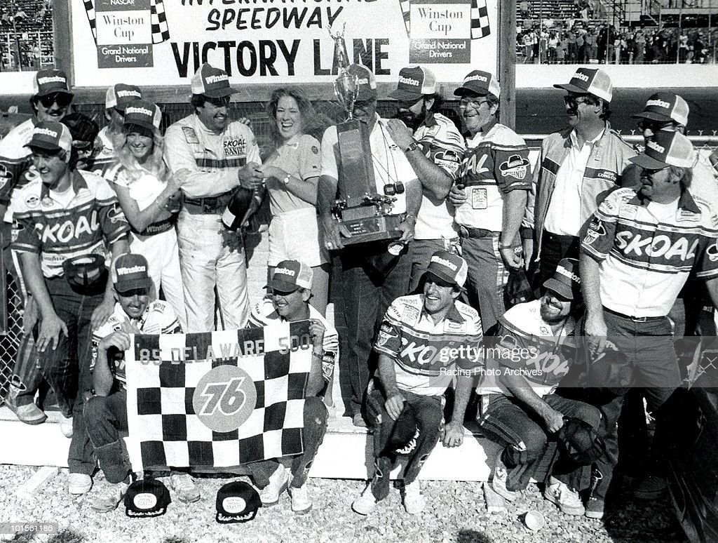 Harry Gant and Hal Needham celebrate in Victory Lane with the rest of the Skoal Bandit crew after winning the Delaware 500. Gant would take home $44,950 for the race.