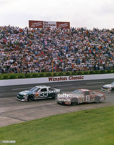 Harry Gant leads Mark Martin on his way to winning the GoodyÕs 500 NASCAR Cup race at Martinsville Speedway. The win was GantÕs fourth in a row...