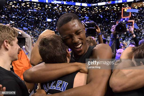 Harry Giles hugs Grayson Allen of the Duke Blue Devils following their 7569 victory against the Notre Dame Fighting Irish during the ACC Basketball...