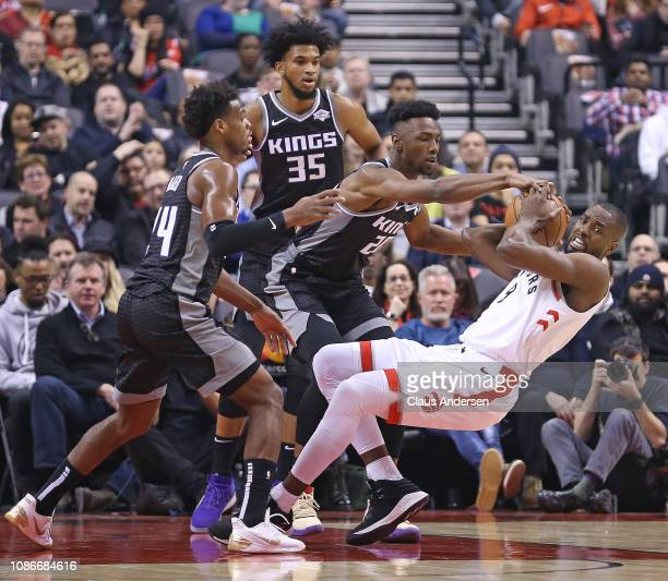 Harry Giles III, Marvin Bagley III, and Buddy Hield of the Sacramento Kings battle against Serge Ibaka of the Toronto Raptors in an NBA game at...