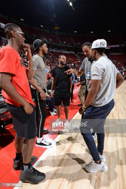 Harry Giles Marvin Bagley III Cory Joseph Vlade Divac and Buddy Hield of the Sacramento Kings attend the game against the Dallas Mavericks on July 8...