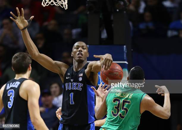 Harry Giles of the Duke Blue Devils blocks a shot by Bonzie Colson of the Notre Dame Fighting Irish during the championship game of the 2017 Men's...