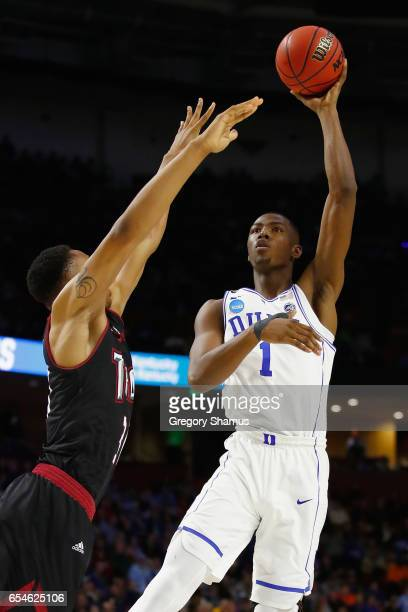 Harry Giles of the Duke Blue Devils shoots against Alex Hicks of the Troy Trojans in the first half during the first round of the 2017 NCAA Men's...