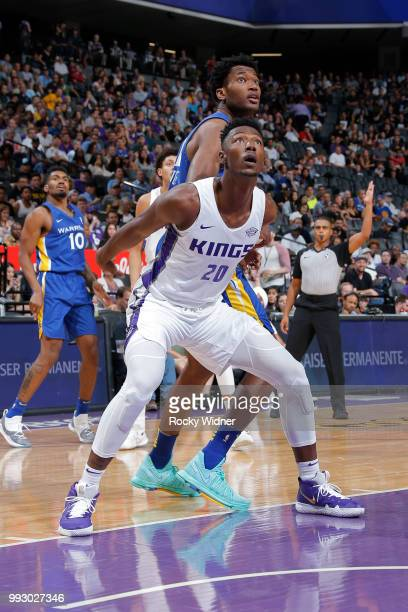 Harry Giles of the Sacramento Kings boxes out Damian Jones of the Golden State Warriors on July 3 2018 at Golden 1 Center in Sacramento California...