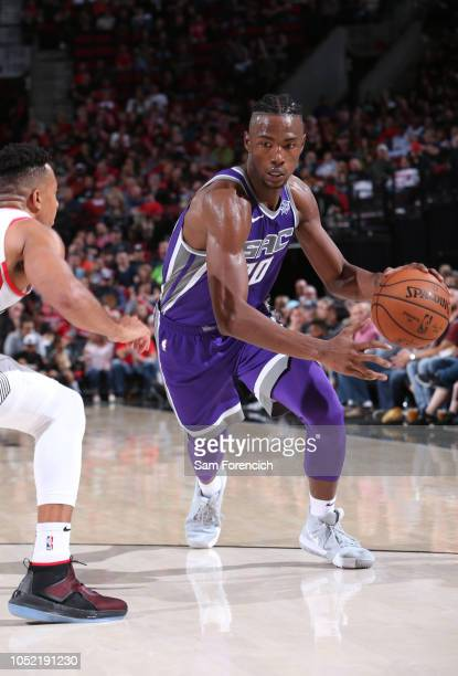 Harry Giles of the Sacramento Kings dribbles the ball against the Portland Trail Blazers on October 12 2018 at the Moda Center Arena in Portland...