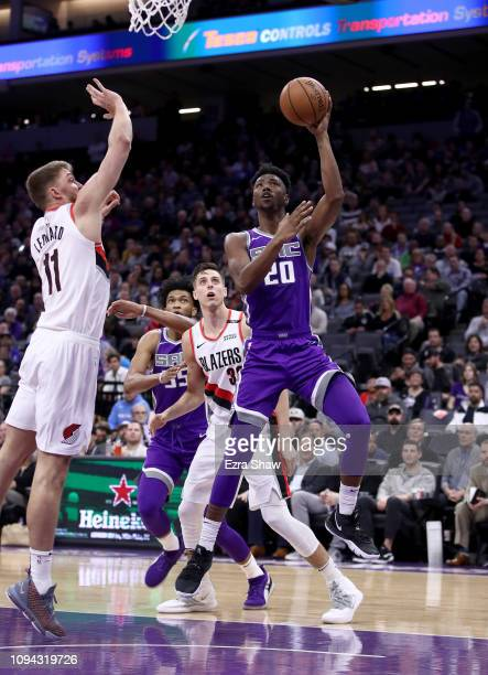 Harry Giles of the Sacramento Kings goes up for a basket against Meyers Leonard of the Portland Trail Blazers at Golden 1 Center on January 14 2019...