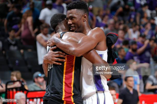 Harry Giles of the Sacramento Kings hugs Bam Adebayo of the Miami Heat after the game between the two teams during the 2018 Summer League at the...