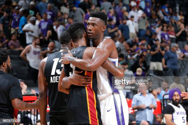 Harry Giles of the Sacramento Kings hugs Derrick Jones Jr #5 of the Miami Heat after the game between the two teams during the 2018 Summer League at...