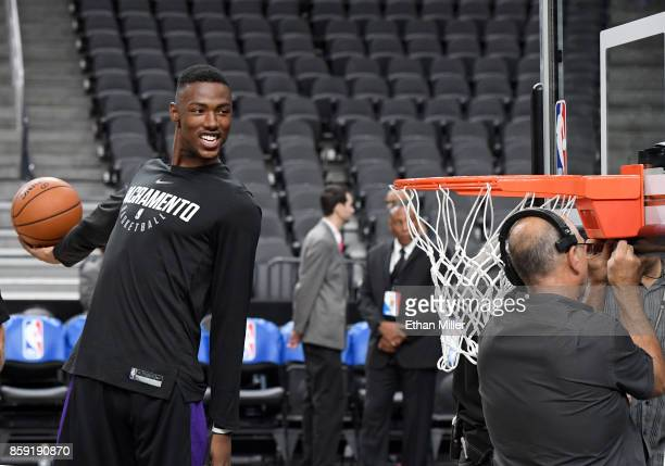 Harry Giles of the Sacramento Kings pretends as if he is going to dunk as the basket is repaired during warmups before the team's preseason game...