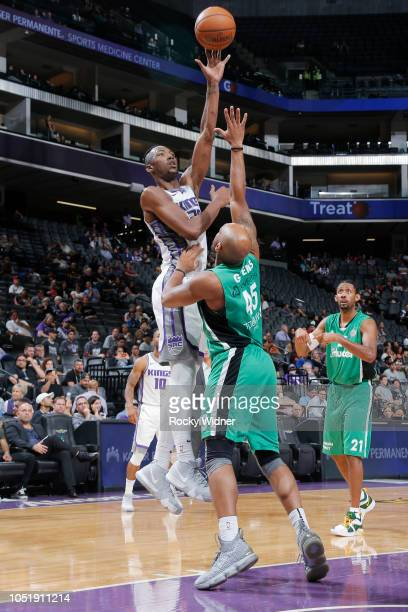 Harry Giles of the Sacramento Kings shoots against Samme Givens of Maccabi Haifa on October 8 2018 at Golden 1 Center in Sacramento California NOTE...