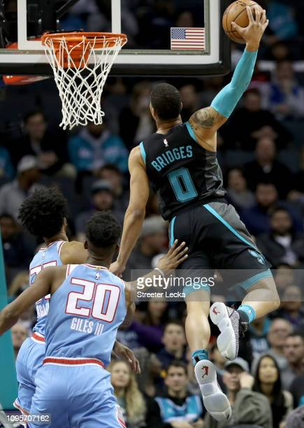 Harry Giles of the Sacramento Kings watches as Miles Bridges of the Charlotte Hornets dunks the ball during their game at Spectrum Center on January...