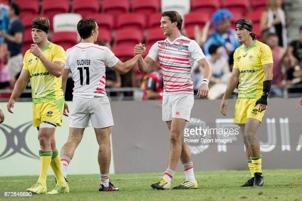 Harry Glover and Will Glover shakes hands after winning the match Australia vs England the Bronze Final of Day 2 of the HSBC Singapore Rugby Sevens...