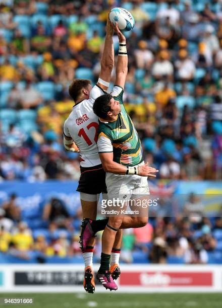 Harry Glover of England and Ruhan Nel of South Africa challenge for the ball in the MenÕs Bronze Medal Final match between England and South Africa...