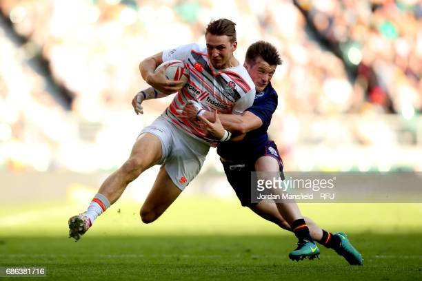 Harry Glover of England is tackled by George Horne of Scotland during the final match between England and Scotland during day two of the HSBC London...