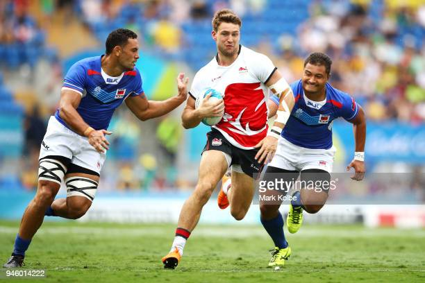 Harry Glover of England runs the ball during the Rugby Sevens match between England and Samoa on day 10 of the Gold Coast 2018 Commonwealth Games at...