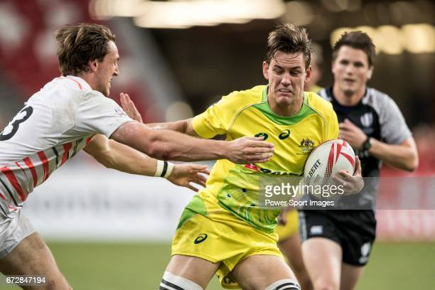 Harry Glover of England tries to stop Lachie Anderson of Australia who runs with the ball during the match Australia vs England the Bronze Final of...